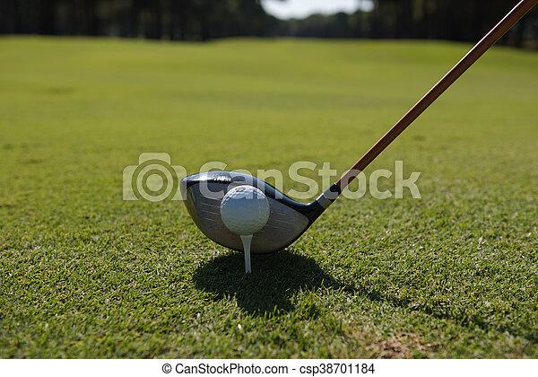 golf player placing ball on tee - csp38701184