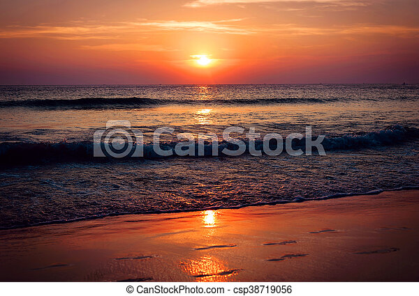 Tropical beach at beautiful sunset - csp38719056