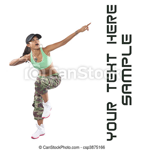 Beautiful woman dancer in hip hop attire striking a pose, pointing upwards.  - csp3875166