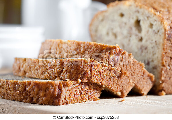 Delicious freshly baked banana bread on wooden board - csp3875253