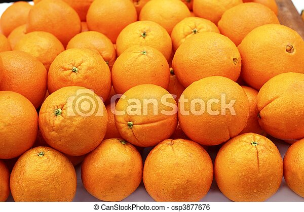 stacked orange fruits rows arranged in market - csp3877676