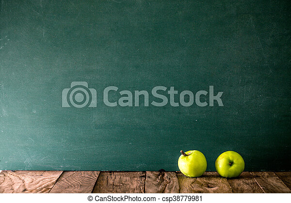 Back to school. School background with supplies. apple and green board