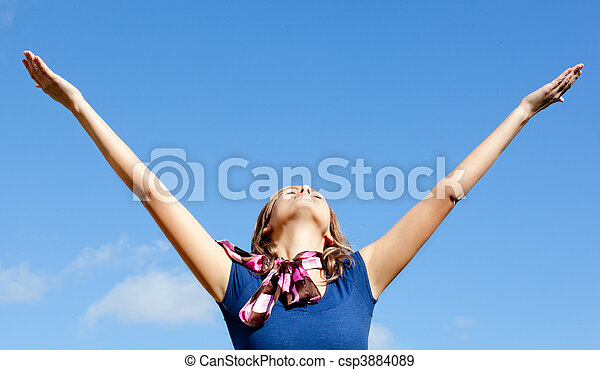 Relaxed  blond woman punching tha air against blue sky - csp3884089