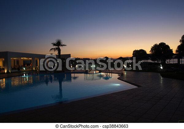 Swimming pool of luxury hotel at dusk