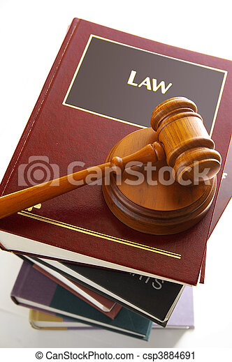 Judges legal gavel on a pile of law books - csp3884691