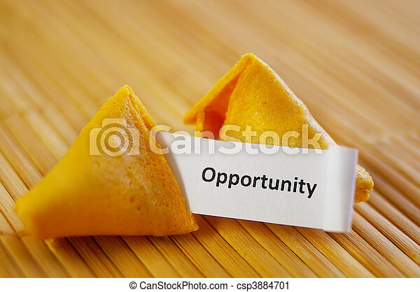 closeup of a fortune cookie with opportunity message - csp3884701