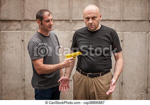 Kapap instructor demonstrates self defense techniques against a gun