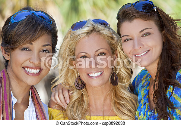 Three Beautiful Young Women Friends Laughing On Vacation - csp3892038