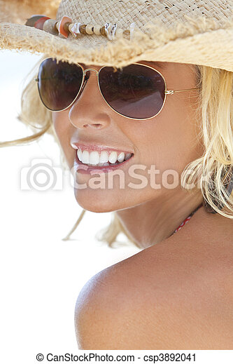 Sexy Blond Girl In Aviator Sunglasses and Straw Cowboy Hat - csp3892041
