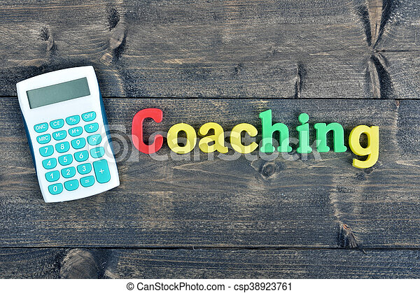 Coaching word on wooden table