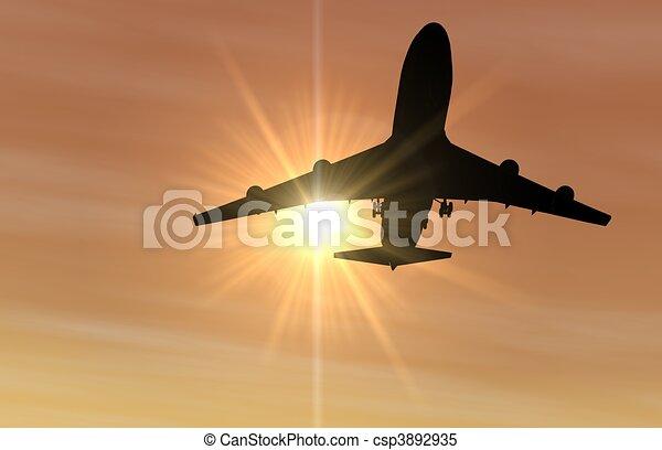 Airplane landing at Sunset - csp3892935