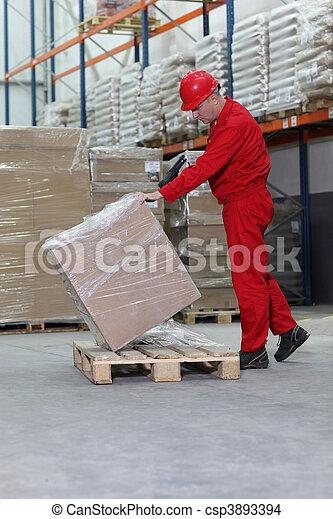 worker with bar code reader - csp3893394
