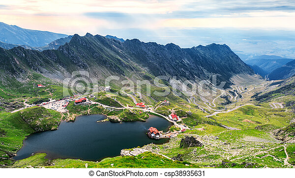 Balea Lake, seen from above. Glacial lake, on Transfagarasan highway in Carpathian mountains, Romania in summer - csp38935631