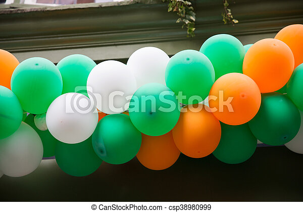 holidays, birthday, celebration and decoration concept - close up of colorful balloons garland