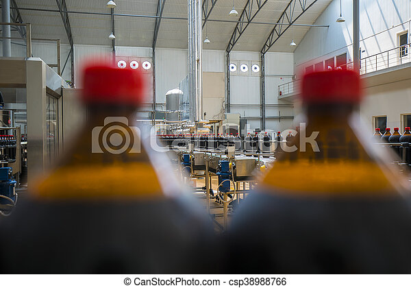 Close up of plastic beer bottle industry on a conveyor belt