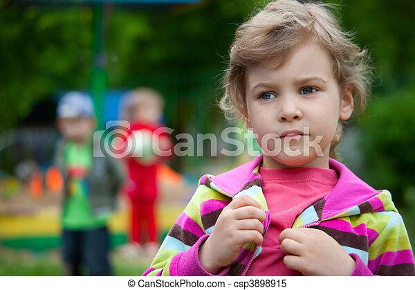The girl plays in a court yard in kindergarten - csp3898915