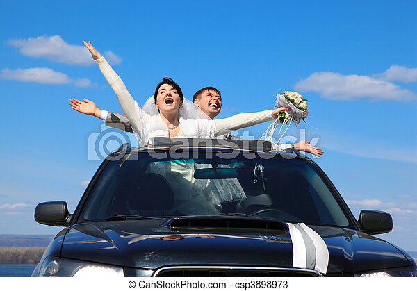 fiance and bride are glad standing in car - csp3898973