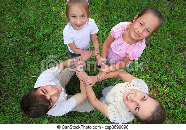 Parents with children stand having joined hands crosswise,  top view - csp3899096