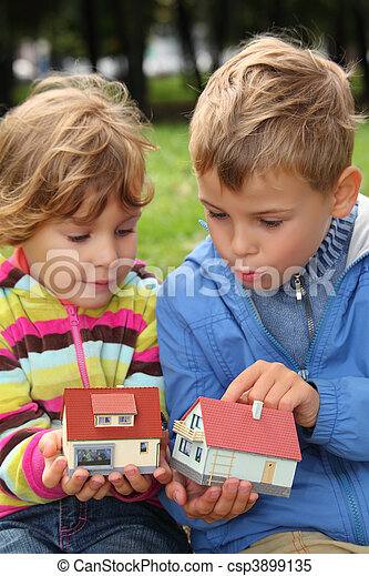 children  with toy small houses in hands outdoor - csp3899135