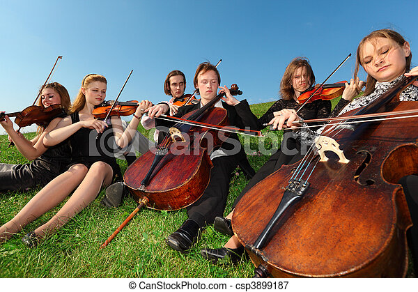 Six violinists sit on  grass and play - csp3899187