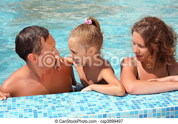 Happy family with little girl bathe in pool - csp3899497