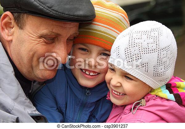 grandfather with grandchildren outdoor - csp3901237