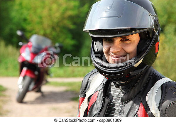 motorcyclist and his bike on country road  - csp3901309