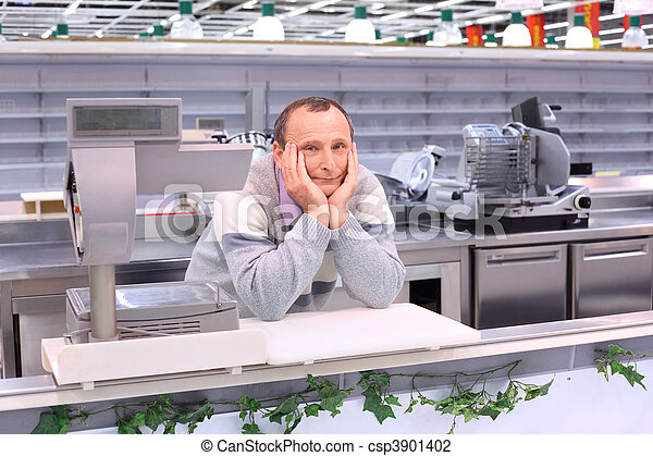 bored seller in shop with empty shelves and counters - csp3901402