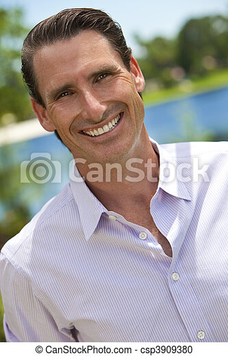 Outdoor Portrait of Handsome Smiling Middle Aged Man - csp3909380