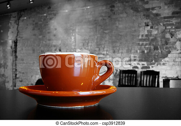 Cappuccino coffee cup and saucer in a brick cafe interior - csp3912839