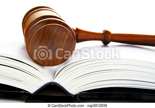 gavel laying on a an open law book - csp3912938
