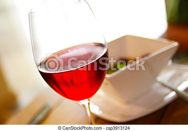Glass of red wine and gourmet bowl - csp3913124
