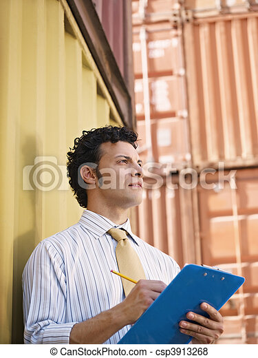 business man with shipping containers - csp3913268