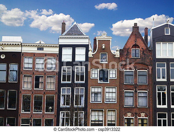 Row of houses and buildings along a canal in Amsterdam, the Netherlands - csp3913322