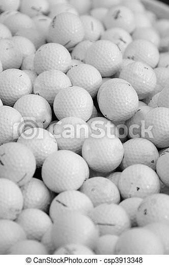 assortment of golf balls in a pile - csp3913348