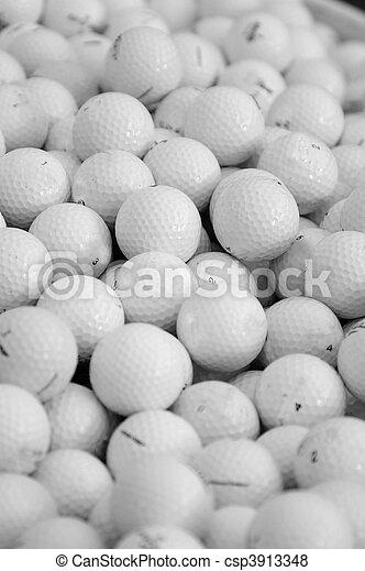 assortment of golf balls in a pile - csp3913348
