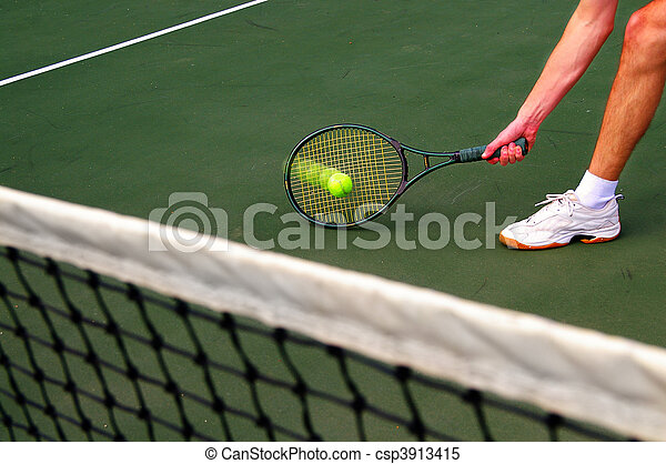 Tennis player running and hitting the ball - csp3913415