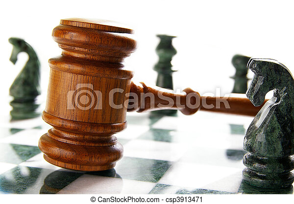 law gavel on a chess board with pieces - csp3913471
