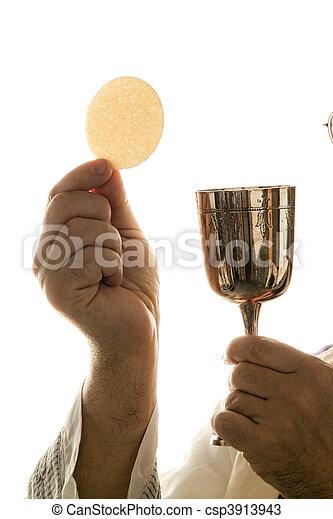 Catholic priest during communion in worship - csp3913943