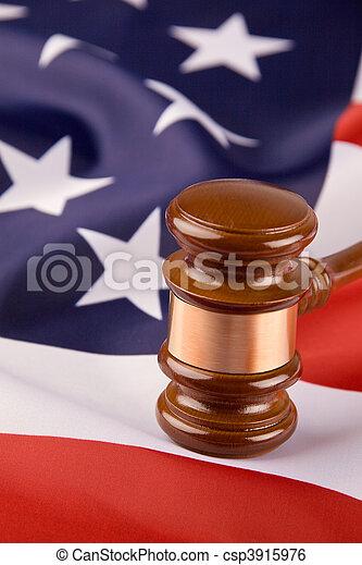 Gavel and the U.S. flag - csp3915976