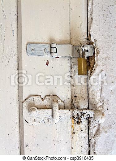 An old door hinge of a House - csp3916435