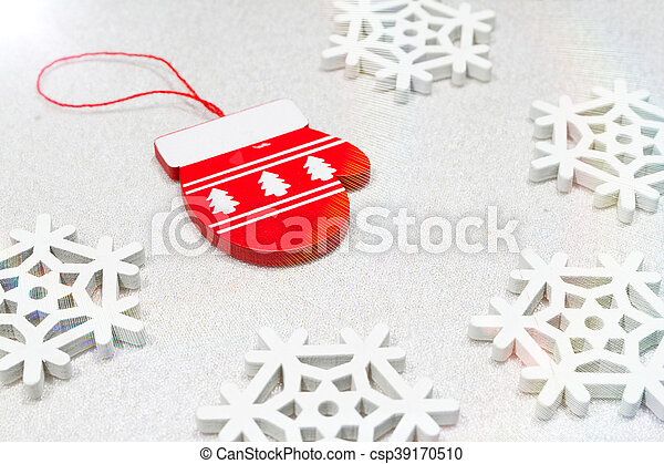 Christmas wooden ornaments toy mitten with ribbon .