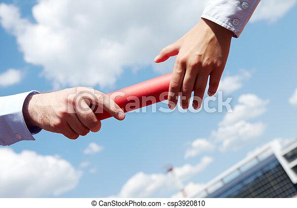 Passing baton - csp3920810