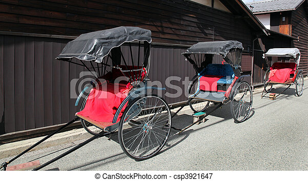 Traditional Japanese rickshaws in Takayama Japan. This type of transportation was once common place but is now only a special occasions or tourist activities. - csp3921647