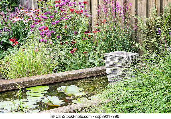Ornamental garden with pond and little fountain - csp39217790