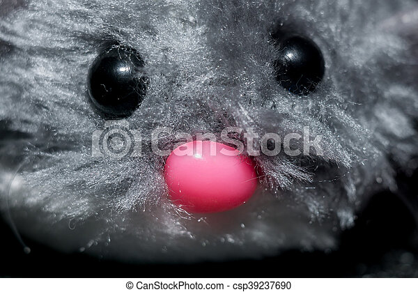 Cute fluffy grey mouse toy for cats close up.