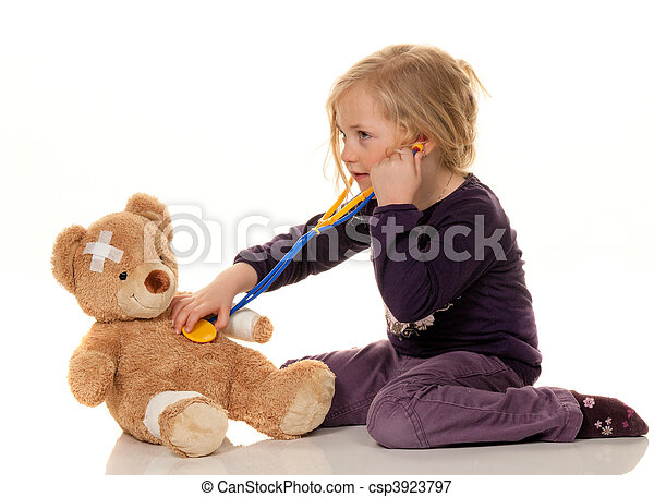 Child with a stethoscope as a doctor. Pediatrician examined patients - csp3923797