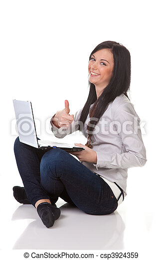 Successful young woman with laptop happy - csp3924359
