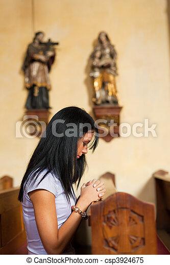 Women pray in a church - csp3924675