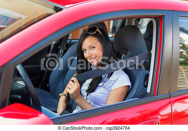Woman with a seat belt in a car - csp3924704